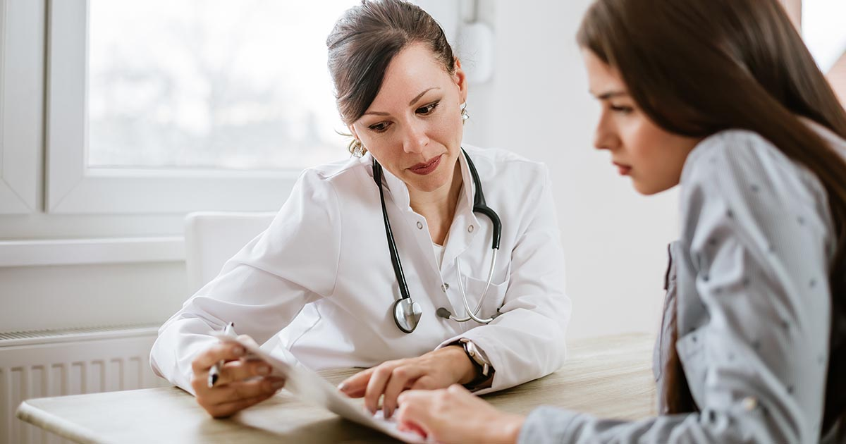 Female doctor giving advice to a female patient