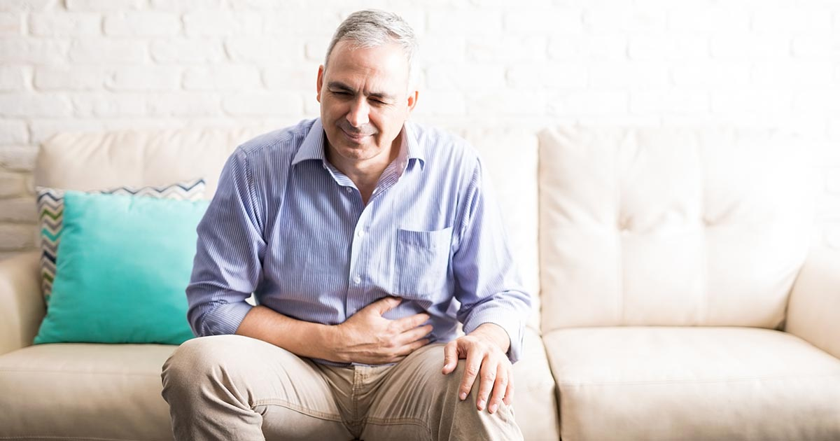 Mature man suffering from stomach pain
