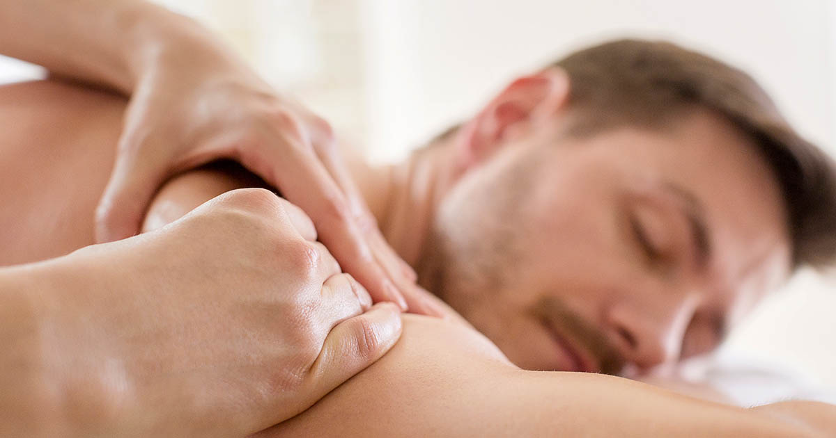 Man receiving a back massage