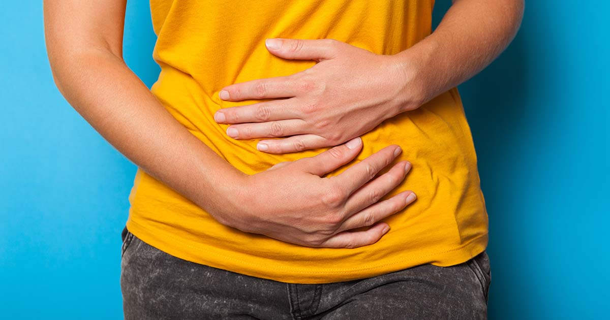 Person experiencing stomach pain