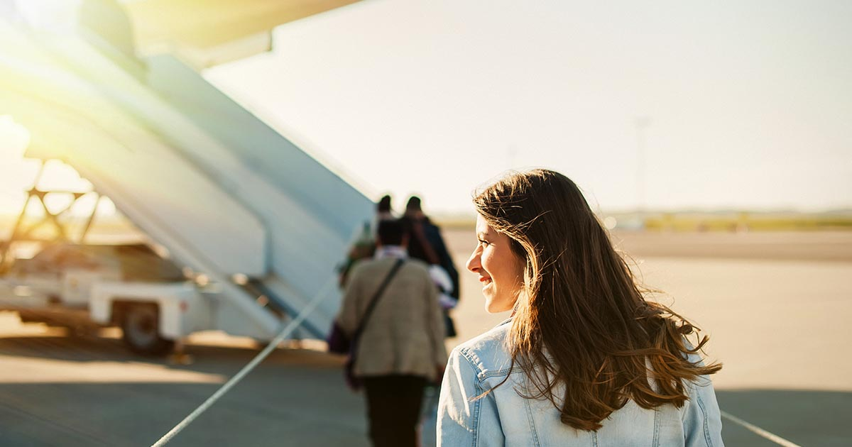 Woman getting in to plane