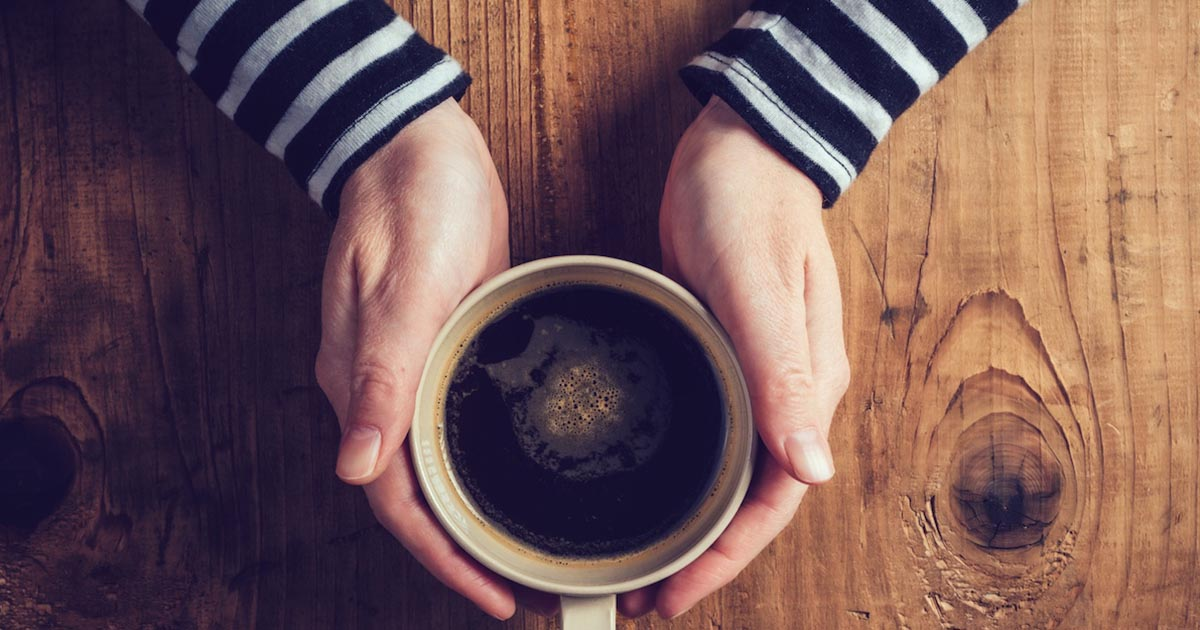 Hands holding a coffee mug