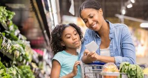 Mother and daughter grocery shopping together